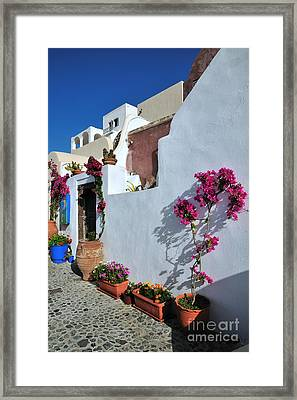 Oia Town Framed Print by George Atsametakis