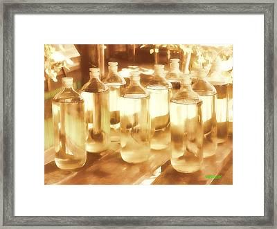 Oil Bottles Framed Print