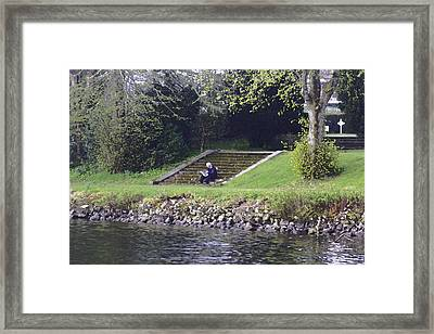 Oil Painting - Man Sitting On Steps Reading Paper On Shore Of Loch Ness Framed Print