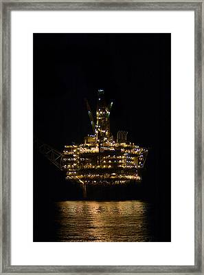 Oil Production Platform At Night Framed Print by Bradford Martin