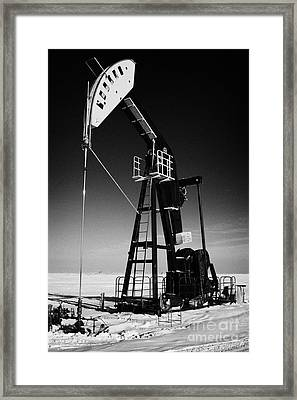 oil pumpjack in winter snow Forget Saskatchewan Canada Framed Print by Joe Fox