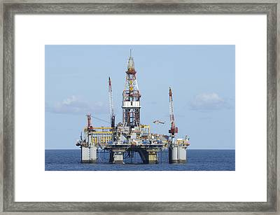 Oil Rig And Helicopter Framed Print by Bradford Martin