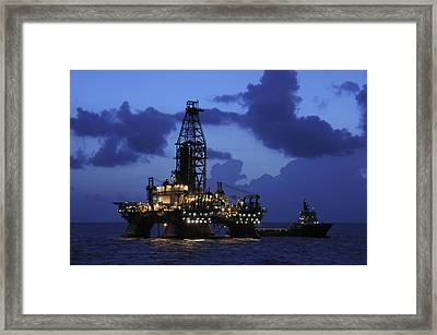 Oil Rig And Vessel At Night Framed Print