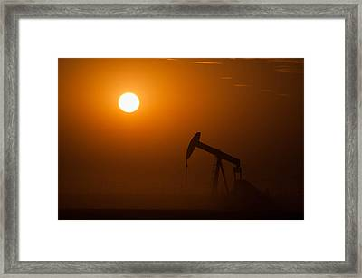 Oil Rig Pumping At Sunset Framed Print by Connie Cooper-Edwards