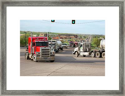 Oil Trucks Framed Print by Jim West