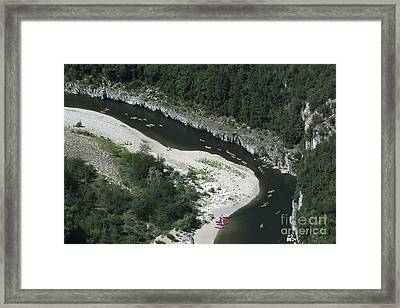 oing down Ardeche River on canoe. Ardeche. France Framed Print