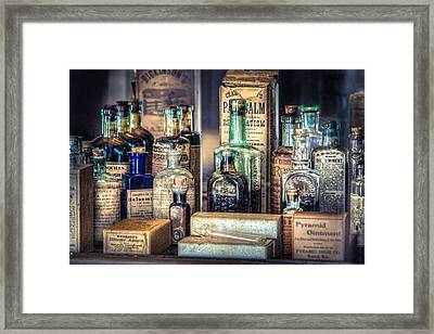 Framed Print featuring the photograph Ointments Tonics And Potions - A 19th Century Apothecary by Gary Heller