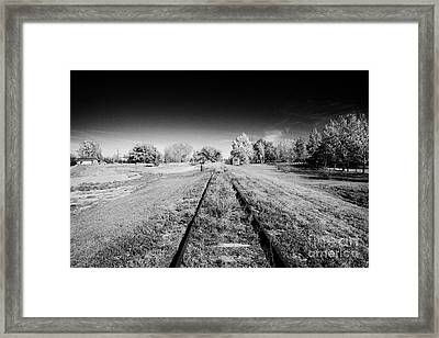 old abandoned rural raised train track bengough Saskatchewan Canada Framed Print by Joe Fox