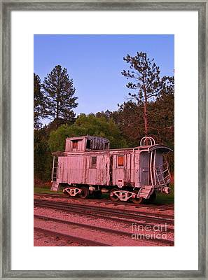 Old And Weathered Caboose Framed Print by John Malone