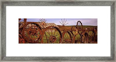 Old Barn With A Fence Made Of Wheels Framed Print by Panoramic Images