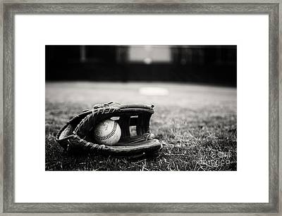 Old Baseball And Glove On Field Framed Print