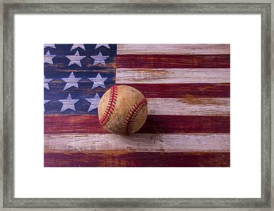 Old Baseball On American Flag Framed Print