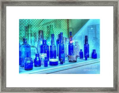 Old Blue Bottles Framed Print by Kaye Menner