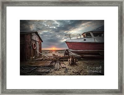 Old Boat At Sunset Framed Print by Ivor Toms
