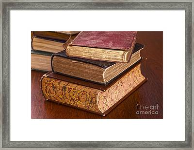 Old Books On Dark Wood Background Framed Print by Colin and Linda McKie