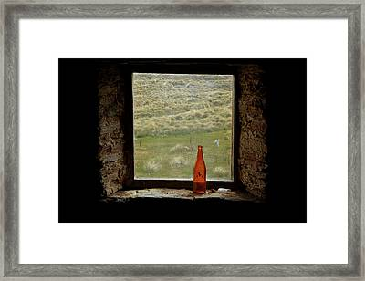 Old Bottle In Window Of Potters Huts Framed Print by David Wall