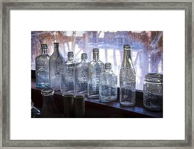 Old Bottles Framed Print by Debra and Dave Vanderlaan