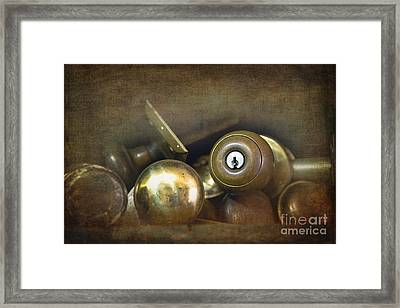 Old Brass Door Knobs Framed Print