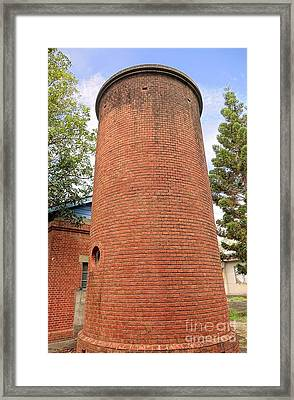 Old Brick Water Tower Framed Print by Yali Shi