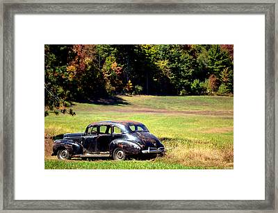 Old Car In A Meadow Framed Print