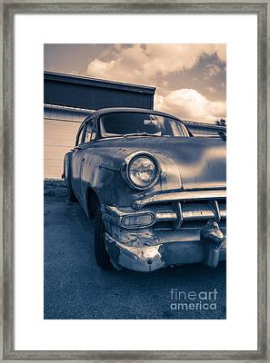 Old Car In Front Of Garage Framed Print