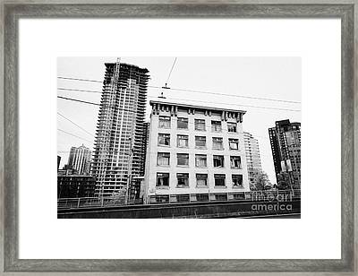 old continental hotel in front of the mark new condo project granville street yaletown Vancouver BC  Framed Print by Joe Fox