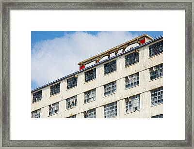 Framed Print featuring the photograph Old Factory Under A Clear Blue Sky by Nick  Biemans