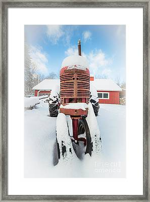 Old Farm Tractor In The Snow Framed Print by Edward Fielding