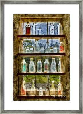 Old Fashioned Milk Bottles Framed Print by Susan Candelario