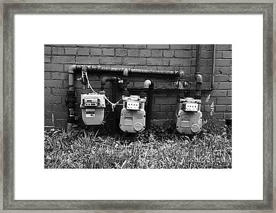 Old Gas Meters Framed Print by James Brunker