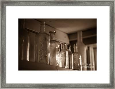 Old Glass Bottles Framed Print