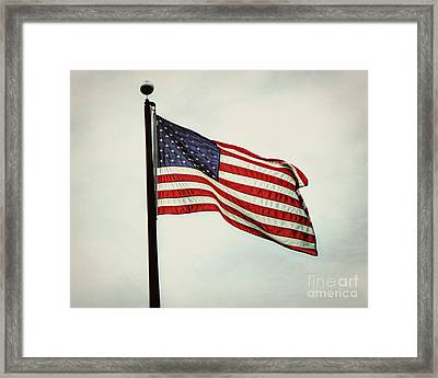 Old Glory In The Wind Framed Print by Emily Kay