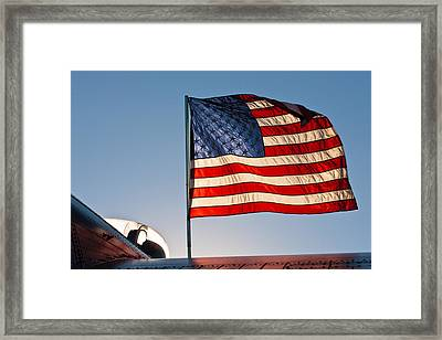 Old Glory Over The Liberator Framed Print by Jeff Sinon