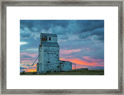Old Granary With Sunset Clouds Framed Print by Chuck Haney