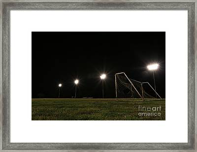 Old Grunge Soccer Goal On A Lit Field At Night Framed Print