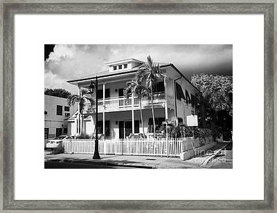 Old Historic Wooden Two Storey Building With White Picket Fence Key West Florida Usa Framed Print by Joe Fox