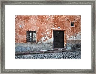 Old House Over Cobbled Ground Framed Print
