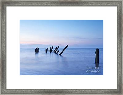 Old Jetty Posts At Sunrise Framed Print