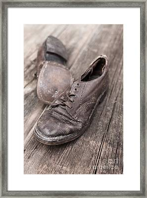 Old Leather Shoes On Wooden Floor Framed Print by Edward Fielding