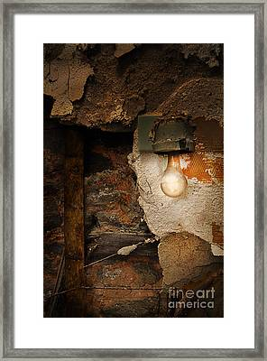 Old Light Fixture On Wall Of Abandoned Building Framed Print by Jill Battaglia