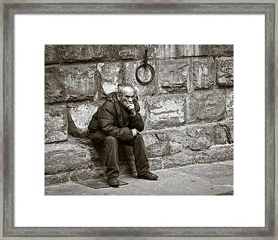 Old Man Pondering Framed Print by Susan Schmitz