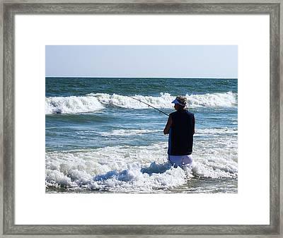 Old Man Sea Fishing Framed Print by Chris Flees