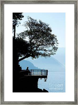Old Man Sitting In Shade Of Tree Overlooking Lake Como Framed Print