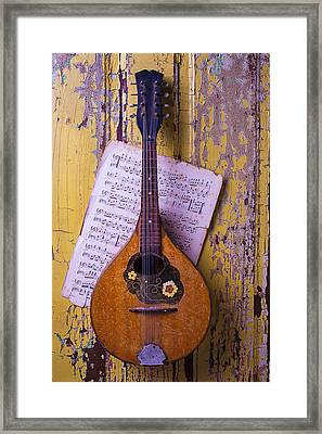 Old Mandolin With Sheet Music Framed Print
