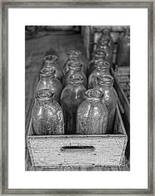 Old Milk Bottles Framed Print by Lee Dos Santos