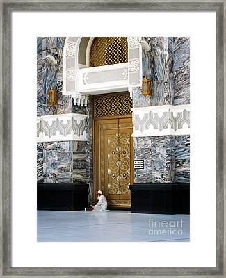 Framed Print featuring the photograph Old Muslim Man Reading The Holy Book Quran by Mohamed Elkhamisy