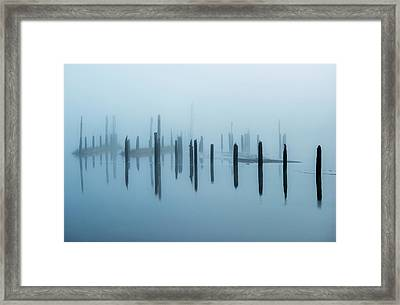 Old Pilings Disappear Into The Mist Framed Print