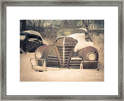 Old Plymouth Classic Car In The Snow Framed Print by Edward Fielding