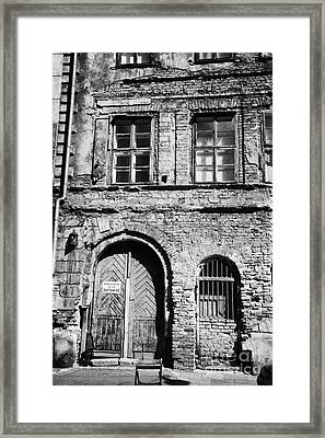 Old Red Brick Crumbling Building In Kazimierz District With Plaster Facade Removed To Expose Brickwork Krakow Framed Print by Joe Fox