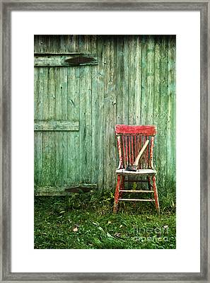 Framed Print featuring the photograph Old Red Chair Near A Barn/digital Oil Painting by Sandra Cunningham